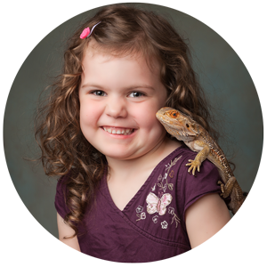 Little girl with pet lizard