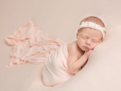 newborn with tieback and wrap