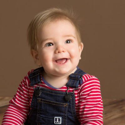 Smiling baby in dungarees