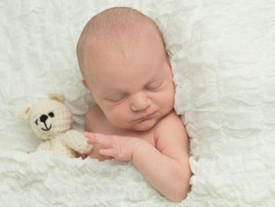 Newborn baby boy with teddy