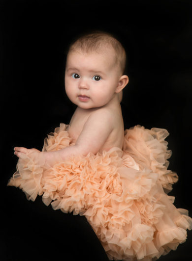 Baby in tutu looking over her shoulder