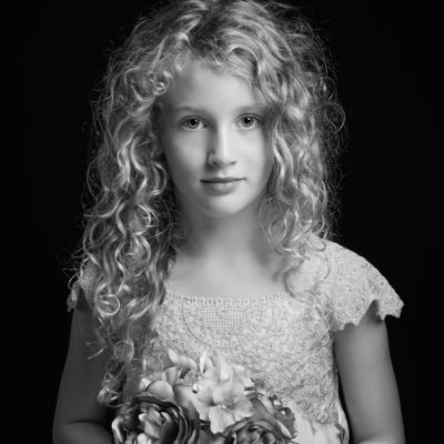 Little girl with lacy dress and tousled hair
