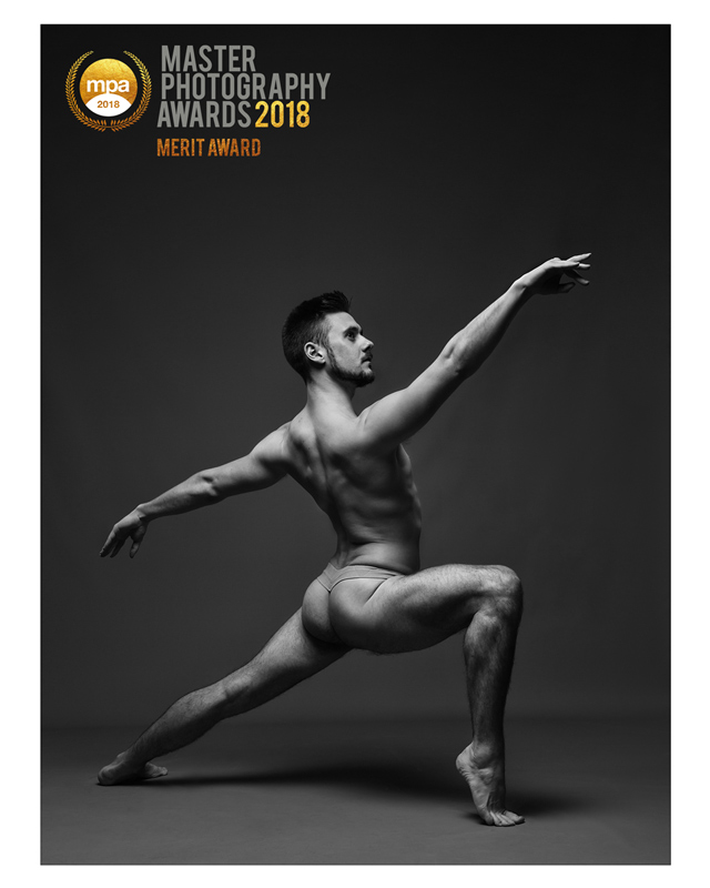 Professional male dancer in black and white showing body physique